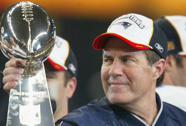 HOUSTON, TX - FEBRUARY 1:  Head coach Bill Belichick of the New England Patriots holds the Lombardi trophy after defeating the Carolina Panthers 32-29 in Super Bowl XXXVIII at Reliant Stadium on February 1, 2004 in Houston, Texas. (Photo by Andy Lyons/Get