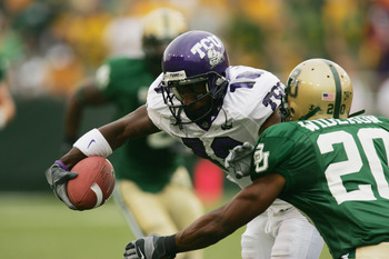 WACO, TX - SEPTEMBER 3:  Wide receiver Quentily Harmon #18 of the TCU Horned Frogs carries the ball during the game against the Baylor Bears on September 3, 2006 at Floyd Casey Stadium in Waco, Texas. TCU defeated Baylor 17-7.  (Photo by Ronald Martinez/G