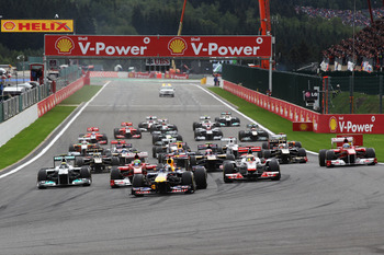 Drivers rush to La Source hairpin on the opening lap of the Belgian Grand Prix.