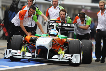 BUDAPEST, HUNGARY - JULY 30:  Adrian Sutil of Germany and Force India is pushed down the pitlane during qualifying for the Hungarian Formula One Grand Prix at the Hungaroring on July 30, 2011 in Budapest, Hungary.  (Photo by Mark Thompson/Getty Images)