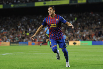 BARCELONA, SPAIN - AUGUST 29:  Alexis Sanchez of FC Barcelona celebrates after scoring his third team's goal during the La Liga match between FC Barcelona and Villarreal CF at Camp Nou on August 29, 2011 in Barcelona, Spain.  (Photo by David Ramos/Getty I