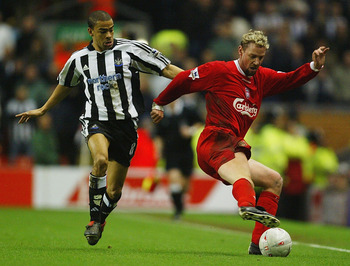 LIVERPOOL, ENGLAND - JANUARY 24:  Kieron Dyer of Newcastle United tackles Stephane Henchoz of Liverpool during the FA Cup Fourth Round match between Liverpool and Newcastle United at Anfield on January 24, 2004 in Liverpool, England.  (Photo by Gary M. Pr