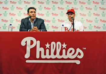 PHILADELPHIA - DECEMBER 16: Pitcher Roy Halladay (R) of the Philadelphia Phillies and senior vice president and general manager Ruben Amaro, Jr. answer questions from the media on December 16, 2009 at Citizens Bank Park in Philadelphia, Pennsylvania. (Pho