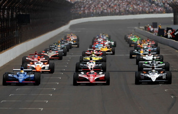 INDIANAPOLIS, IN - MAY 29:  The field drives down the frontstretch on a parade lap prior to the IZOD IndyCar Series Indianapolis 500 Mile Race at Indianapolis Motor Speedway on May 29, 2011 in Indianapolis, Indiana.  (Photo by Jonathan Ferrey/Getty Images