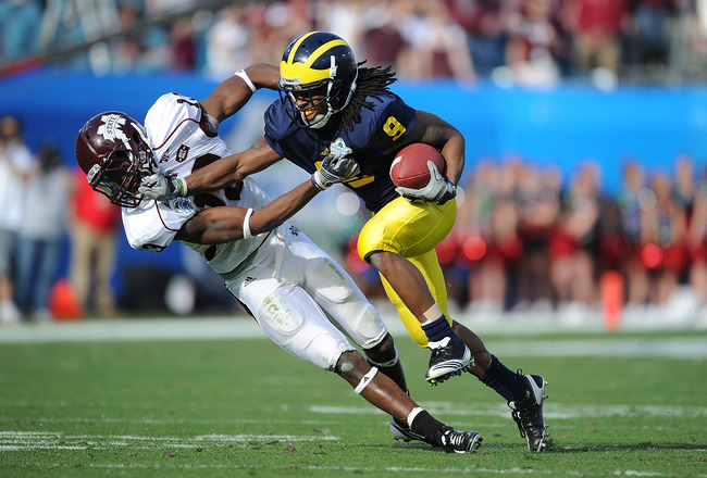 JACKSONVILLE, FL - JANUARY 01:  Martavious Odoms #9 of the Michigan Wolverines is tackled by Johnthan Banks of #13 of the Mississippi State Bulldogs during the Gator Bowl at EverBank Field on January 1, 2011 in Jacksonville, Florida  (Photo by Rick Dole/G