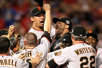 ARLINGTON, TX - NOVEMBER 01:  Mark DeRosa (C) of the San Francisco Giants celebrates with his teammates after they won the World Series against the Texas Rangers in Game Five of the 2010 MLB World Series at Rangers Ballpark in Arlington on November 1, 201