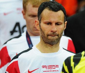 LONDON, ENGLAND - MAY 28:  Ryan Giggs of Manchester United looks dejected after defeat in the UEFA Champions League final between FC Barcelona and Manchester United FC at Wembley Stadium on May 28, 2011 in London, England.  (Photo by Clive Mason/Getty Ima