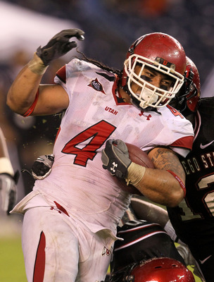 SAN DIEGO - NOVEMBER 20:  Running back Matt Asiata #4 of the Utah Utes carries the ball against the San Diego State Aztecs at Qualcomm Stadium on November 20, 2010 in San Diego, California.  Utah won 38-34.  (Photo by Stephen Dunn/Getty Images)
