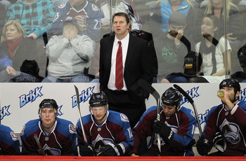 DENVER - DECEMBER 23:  Head coach Joe Sacco of the Colorado Avalanche looks on as he leads his team against the Minnesota Wild at the Pepsi Center on December 23, 2010 in Denver, Colorado. The Wild defeated the Avalanche 3-1.  (Photo by Doug Pensinger/Get