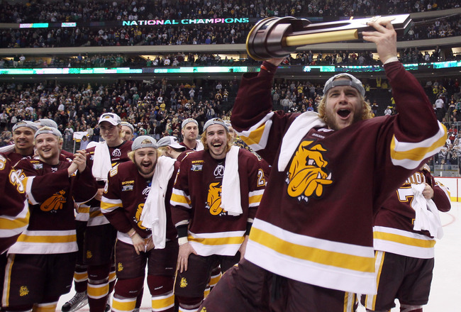 ST. PAUL, MN - APRIL 09:  Trent Palm #5 of the Minnesota Duluth Bulldogs celebrates with the trophy after the championship game of the 2011 NCAA Men's Frozen Four on April 9, 2011 at the Xcel Energy Center in St. Paul, Minnesota. The Minnesota Duluth Bull