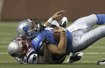 DETROIT - AUGUST 27:  Matthew Stafford #9 of the Detroit Lions is sacked by Kyle Arrington #27 of the New England Patriots during the first quarter of the game at Ford Field on August 27, 2011 in Detroit, Michigan. The Lions defeated the Patriots 34-10.