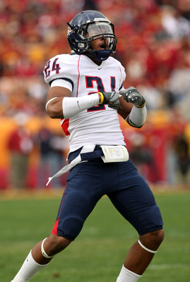LOS ANGELES, CA - DECEMBER 05:  Cornerback Trevin Wade #24 of the Arizona Wildcats celebrates after making an interception in the first quarter against the USC Trojans on December 5, 2009 at the Los Angeles Coliseum in Los Angeles, California.  Arizona wo