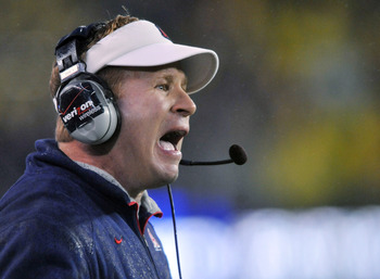 EUGENE, OR - NOVEMBER 26: Head coach Mike Stoops of the Arizona Wildcats yells out to his team in the first quarter of the game against the Oregon Ducks at Autzen Stadium on November 26, 2010 in Eugene, Oregon.The Ducks won the game 48-29. (Photo by Steve