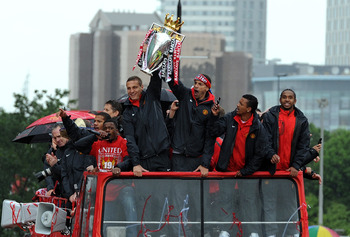 MANCHESTER, ENGLAND - MAY 30: Rio Ferdinand (R) and Nemanja Vidic of Manchester United lift the trophy during the Manchester United Premier League Winners Parade at Old Trafford on May 30, 2011 in Manchester, United Kingdom.  (Photo by Chris Brunskill/Get