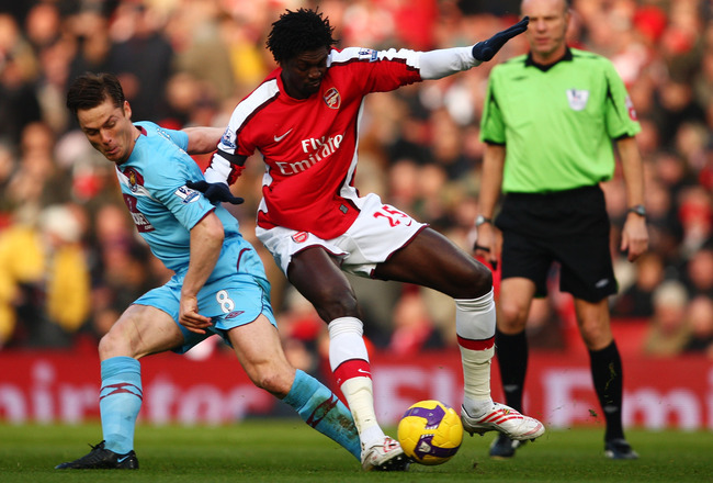 LONDON - JANUARY 31:  Scott Parker of West Ham United challenges Emmanuel Adebayor of Arsenal during the Premier League match between Arsenal and West Ham United at the Emirates Stadium on January 31, 2009 in London, England.  (Photo by Richard Heathcote/