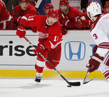 DETROIT, MI - APRIL 16: Daniel Cleary #11 of the Detroit Red Wings skates with the puck towards Keith Yandle #3 of the Phoenix Coyotes in Game Two of the Western Conference Quarterfinals during the 2011 Stanley Cup Playoffs at Joe Louis Arena on April 16,