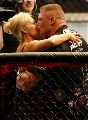 Brock_20kisses_20rena_20sable_20lesnar_20after_20winning_20title_20at_20ufc_2091_display_image