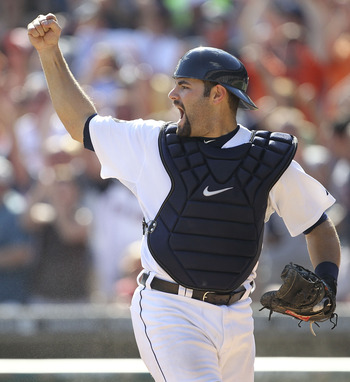 DETROIT, MI - AUGUST 21:  Alex Avila #13 of the Detroit Tigers celebrates the final out as he tags out Kosuke Fukudome #1 of the Cleveland Indians to end the game as the Tigers defeated the Indians 8-7 at Comerica Park on August 21, 2011 in Detroit, Michi