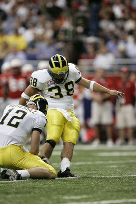 SAN ANTONIO - DECEMBER 28:  Kicker Garrett Rivas #38 of the Michigan Wolverines attempts a field goal against the Nebraska Cornhuskers during the MasterCard Alamo Bowl on December 28, 2005 at the Alamodome in San Antonio, Texas.  The Huskers won 32-28.  (