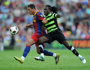 BARCELONA, SPAIN - SEPTEMBER 11:  Adriano (L) of Barcelona duels for the ball with Royston Drenthe of Hercules during the La Liga match between Barcelona and Hercules at the Camp Nou stadium on September 11, 2010 in Barcelona, Spain. Barcelona lost the ma