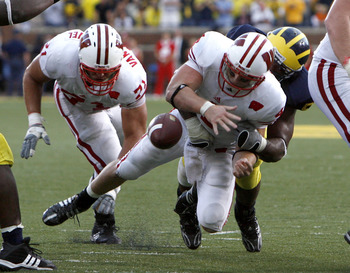 ANN ARBOR, MI - SEPTEMBER 27: Allan Evridge #4 of the Wisconsin Badgers fumbles the ball late in the forth quarter on a hit by Brandon Graham #55 of the Michigan Wolverines on September 27, 2008 at Michigan Stadium in Ann Arbor, Michigan. (Photo by Gregor