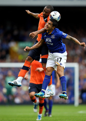 LIVERPOOL, ENGLAND - AUGUST 20:  Daniel Gabbidon of Queens Park Rangers goes up for a header with Tim Cahill of Everton during the Barclays Premier League match between Everton and Queens Park Rangers at Goodison Park on August 20, 2011 in Liverpool, Engl