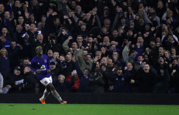 LIVERPOOL, ENGLAND - FEBRUARY 05:  Louis Saha of Everton runs away to celebrate after scoring his teams third goal and equalizer during the Barclays Premier League match between Everton and Blackpool at Goodison Park on February 5, 2011 in Liverpool, Engl