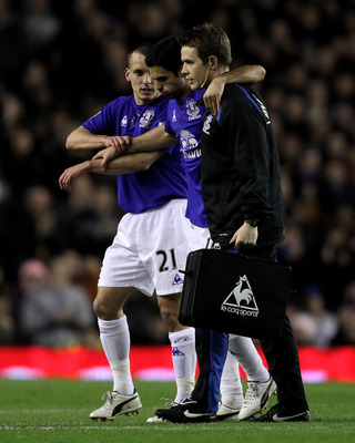 LIVERPOOL, ENGLAND - MARCH 09:  Mikel Arteta of Everton is helped off the pitch with an injury during the Barclays Premier League match between Everton and Birmingham City at Goodison Park on March 9, 2011 in Liverpool, England.  (Photo by Alex Livesey/Ge