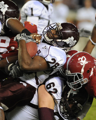 TUSCALOOSA, AL - NOVEMBER 13: Running back Vick Ballard #28  of the Mississippi State Bulldogs rushes upfield against the Alabama Crimson Tide November 13, 2010 at Bryant-Denny Stadium in Tuscaloosa, Alabama.  (Photo by Al Messerschmidt/Getty Images)
