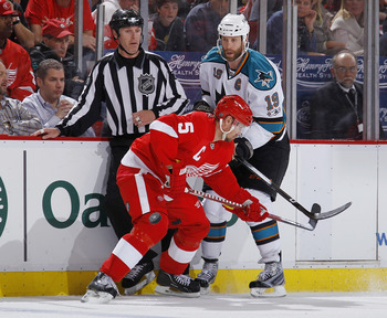 DETROIT - MAY 10: Nicklas Lidstrom #5 of the Detroit Red Wings battles for position with Joe Thornton #19 of the San Jose Sharks during the third period in Game Six of the Western Conference Semifinals during the 2011 NHL Stanley Cup Playoffs on May 10, 2