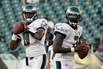 PHILADELPHIA, PA - AUGUST 11:  Vince Young #9 and Michael Vick #7 of the Philadelphia Eagles warm up before playing against the Baltimore Ravens during their pre season game on August 11, 2011 at Lincoln Financial Field in Philadelphia, Pennsylvania.  (Ph