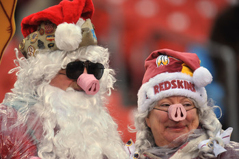 LANDOVER, MD - DECEMBER 12:  Fans of the Washington Redskins cheer against the Tampa Bay Buccaneers  at FedExField on December 12, 2010 in Landover, Maryland. The Buccaneers defeated the Redskins 17-16. (Photo by Larry French/Getty Images)