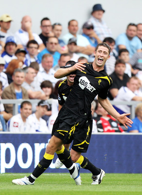 LONDON, ENGLAND - AUGUST 13:  Gary Cahill of Bolton celebrates after scoring the opening goal during the Barclays Premier League match between Queens Park Rangers and Bolton Wanderers at Loftus Road on August 13, 2011 in London, England.  (Photo by Michae