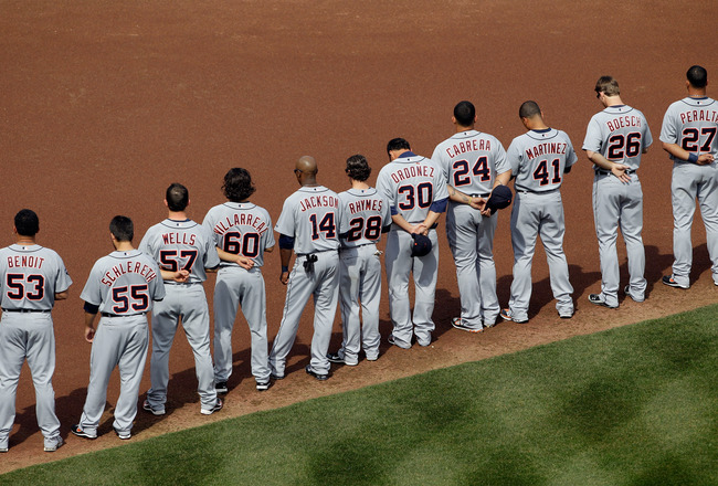 BALTIMORE, MD - APRIL 04:  Members of the Detroit Tigers line up during opening day ceremonies against the Baltimore Orioles at Oriole Park at Camden Yards on April 4, 2011 in Baltimore, Maryland.  (Photo by Rob Carr/Getty Images)