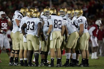 PALO ALTO, CA - NOVEMBER 28:  The Notre Dame Fighting Irish offense huddles up during their game against the Stanford Cardinal at Stanford Stadium on November 28, 2009 in Palo Alto, California.  (Photo by Ezra Shaw/Getty Images)