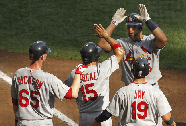 MILWAUKEE, WI - SEPTEMBER 1:  Albert Pujols #5 of the St. Louis Cardinals celebrates a grand slam home run with his teammates Brandon Dickson #65, Rafael Furcal #15 and Jon Jay #19 in the third inning of their game against the Milwaukee Brewers at Miller