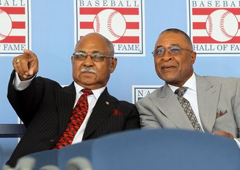 COOPERSTOWN, NY - JULY 24:  Hall of Famers Billy Williams (L) and Ozzie Smith at Clark Sports Center during the Baseball Hall of Fame induction ceremony on July 24, 2011 in Cooperstown, New York.  (Photo by Jim McIsaac/Getty Images)