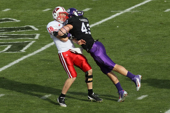 PASADENA, CA - JANUARY 01:  Quarterback Scott Tolzien #16 of the Wisconsin Badgers is hit by linebacker Tank Carder #43 of the TCU Horned Frogs during the 97th Rose Bowl game on January 1, 2011 in Pasadena, California.  (Photo by Stephen Dunn/Getty Images