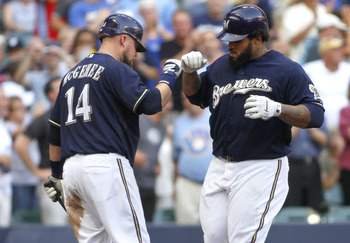 MILWAUKEE, WI - SEPTEMBER1:  Casey McGehee #14 celebrates with Prince Fielder #28 of the Milwaukee Brewers after Fielder hit a home run in the 8th inning during their game against the St Louis Cardinals at Miller Park on September 1, 2011 in Milwaukee, Wi