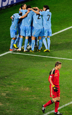 Forlan celebrating with his Uruguayan team.