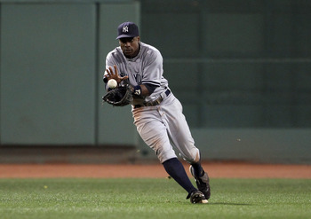 BOSTON, MA - AUGUST 30:  Curtis Granderson #14 of the New York Yankees chases down a hit in the sixth inning against the Boston Red Sox on August 30, 2011 at Fenway Park in Boston, Massachusetts.  (Photo by Elsa/Getty Images)
