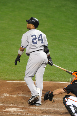 BALTIMORE, MD - AUGUST 28:  Robinson Cano #24 of the New York Yankees hits a home run in sixth inning during a baseball game against the Baltimore Orioles at Oriole Park at Camden Yards on August 28, 2011 in Baltimore, Maryland. The Yankees won 8-3.  (Pho