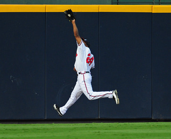 ATLANTA - AUGUST 31:  Michael Bourn #24 of the Atlanta Braves makes a running catch against the Washington Nationals at Turner Field on August 31, 2011 in Atlanta, Georgia. (Photo by Scott Cunningham/Getty Images)