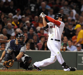 BOSTON, MA - SEPTEMBER 1:  Jacoby Ellsbury # 2 of the Boston Red Sox swings at a pitch in the third inning as catcher Russell Martin #55 of the New York Yankees looks on at Fenway Park on September 1, 2011 in Boston, Massachusetts. (Photo by Darren McColl