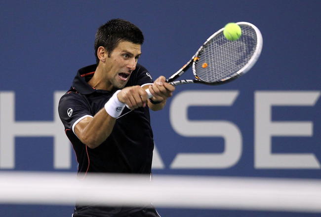 NEW YORK, NY - SEPTEMBER 01:  Novak Djokovic of Serbia returns a shot against Carlos Berlocq of Argentina during Day Four of the 2011 US Open at the USTA Billie Jean King National Tennis Center on September 1, 2011 in the Flushing neighborhood of the Quee