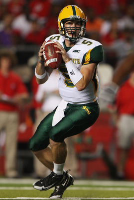 NEW BRUNSWICK, NJ - SEPTEMBER 02:  Chris Walley #5 of the Norfolk State Spartans drops back against the Rutgers Scarlet Knights at Rutgers Stadium on September 2, 2010 in New Brunswick, New Jersey.  (Photo by Andrew Burton/Getty Images)