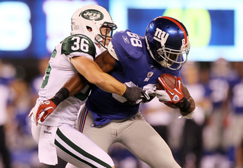 EAST RUTHERFORD, NJ - AUGUST 29:  Hakeem Nicks #88 of the New York Giants tries to break a tackle against Jim Leonhard #36 of the New York Jets during their pre season game on August 29, 2011 at MetLife Stadium in East Rutherford, New Jersey.  (Photo by J
