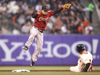 SAN FRANCISCO, CA - AUGUST 25:  Jose Altuve #27 of the Houston Astros throws to first as Jeff Keppinger #8 of the San Francisco Giants slides int o second on a double play ball hit by Carlos Beltran in the first inning at AT&amp;T Park on August 25, 2011 in S