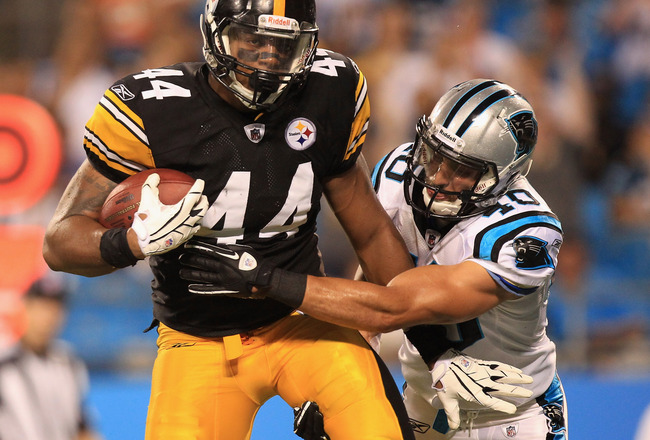 CHARLOTTE, NC - SEPTEMBER 01:  Weslye Saunders #44 of the Pittsburgh Steelers catches a touchdown against Michael Greco #40 the Carolina Panthers during their preseason game at Bank of America Stadium on September 1, 2011 in Charlotte, North Carolina.  (P