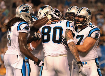 CHARLOTTE, NC - SEPTEMBER 01:  Jeremy Shockey #80 of the Carolina Panthers celebrates with his teammates after a touchdown against the Pittsburgh Steelers during their preseason game at Bank of America Stadium on September 1, 2011 in Charlotte, North Caro